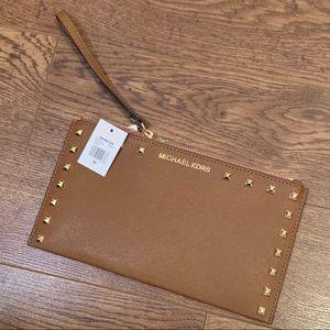 Micheal Kors brown stud zip clutch/wristlet